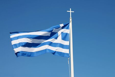 Waving flag of Greece on the blue sky.