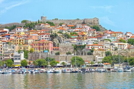 View of Kavala city: yachts in the harbor, medieval fortress on the hill. Eastern Macedonia. Greece.