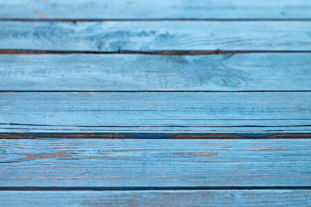 Plank wooden blue background close up.