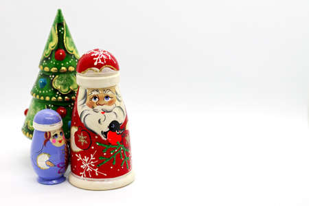 Russian wooden dolls - matrioshka. Father Frost, Snow-maiden and new year tree. Popular souvenirs from Russia
