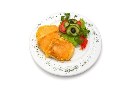 deep fried cheese in egg, with fresh vegetables, served on plate. photo