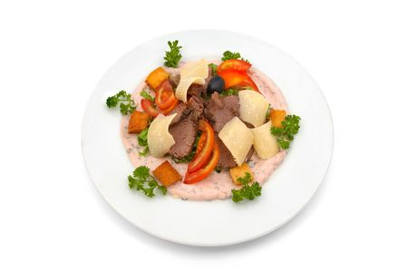 Veal salad with sliced fresh tomato, parmesan chips and cracker pieces, dressed with rose sauce and parsley Stock Photo - 574351