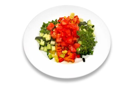 Salad made of fresh tomatoes, cucumbers, red, yellow and green peppers, parsley. Stock Photo - 574347