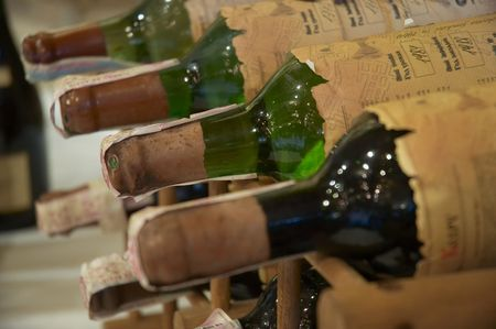 wine bottles laying in wooden rack photo