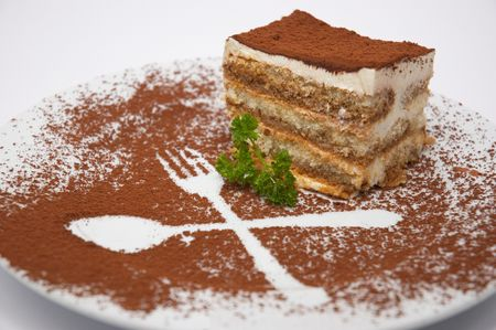 rich flavor: tiramisu dessert served on plate with cpecial decoration. isolated. shallow dof.