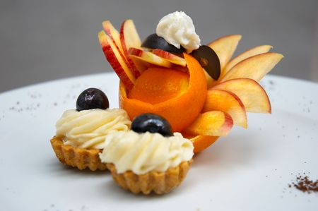 petit four served on plate with original fruit design Stock Photo - 574316