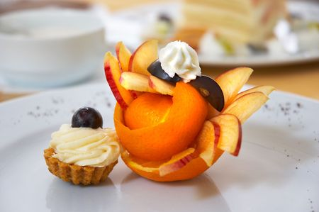 petit four served on plate with original fruit design Stock Photo - 574313
