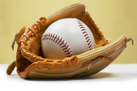 hardball: baseball ball in kidsjunior sized glove