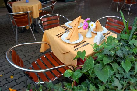 Empty restaurant outdoor tables waiting for new customers Stock Photo