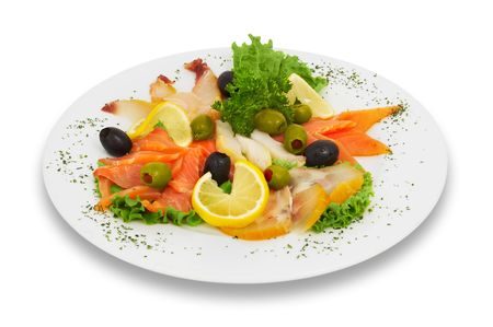 assortted fish slices, decorated with lemons, leaves of lettuce and parsley Stock Photo - 574300
