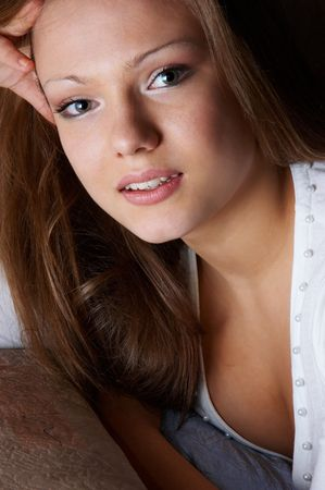 wistful: wistful glance of quiet pretty woman. facial closeup. Stock Photo