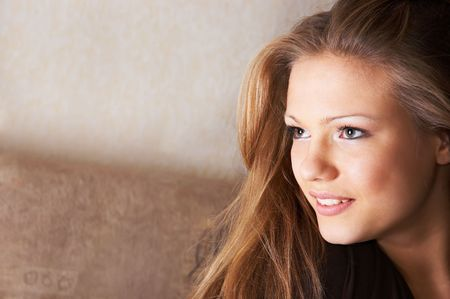 waiting glance: portrait of pretty young woman with sidelong glance and scarcely perceptible smile