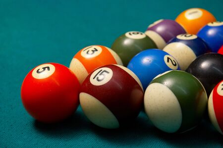 poolball: colored pool balls on felt, shallow DOF.