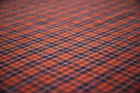 checkered celtic fabric textured background. shallow DOF. photo