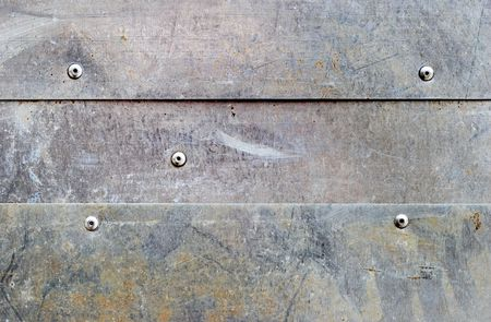 oxidized: banded grunge dirty aluminium background with rivets Stock Photo