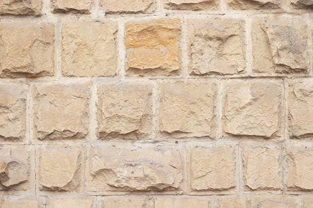 warm colored limestone rough relief bricks texture Stock Photo - 668230