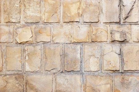 cementum: Large limestone bricks wall grunge background