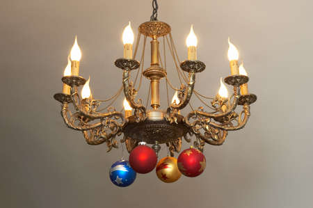 candleholders: ornate hanging lustre with christmas decoration Stock Photo