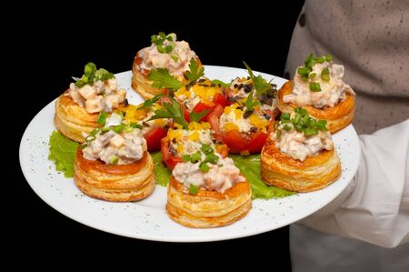 held: tartlets with salad on dish, held by waiter