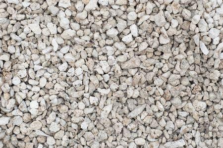 Petites pierres broyées (route métal). Fond texturé.  Banque d'images