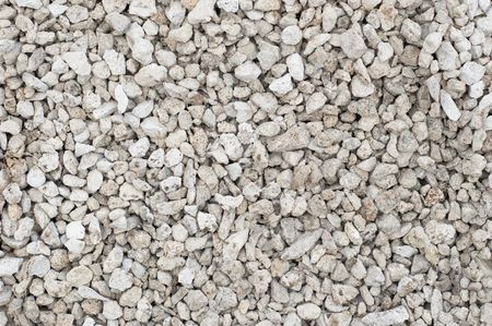 kleine gemalen stenen (weg metaal) materiaal. getextureerde achtergrond.