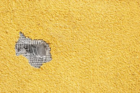 yellow rough stucco, deeply punched. material texture. Stock Photo - 722787