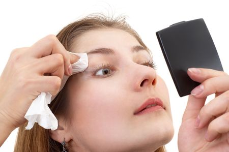 removing: young lady with small mirror in her hand, removing makeup Stock Photo