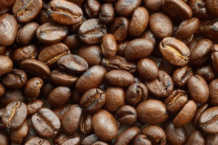 textured background: brown roasted coffee beans macro closeup photo