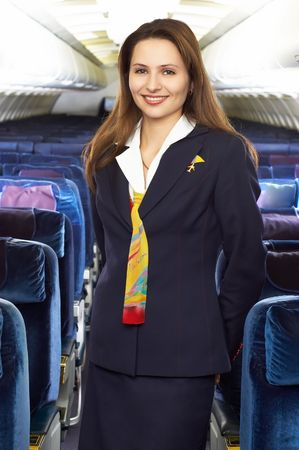 air hostess in the empty jet airliner cabin Stock Photo