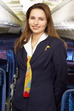air hostess: air hostess in the empty airliner cabin Stock Photo
