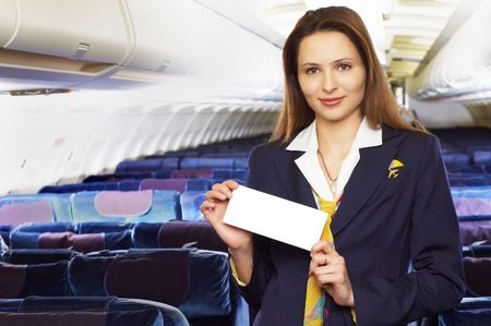 air hostess: air hostess (stewardess) in the empty airliner cabin Stock Photo