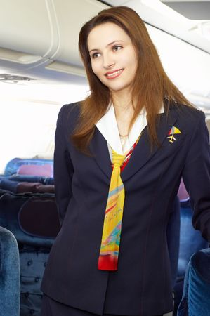 air crew: air hostess (stewardess) in the empty airliner cabin Stock Photo