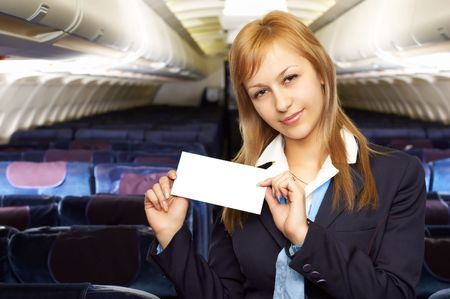 air hostess: blond air hostess (stewardess) in the empty airliner cabin Stock Photo