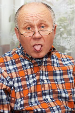Casual bald senior man emotional portrait series. Sticking out the tongue. Stock Photo - 823473