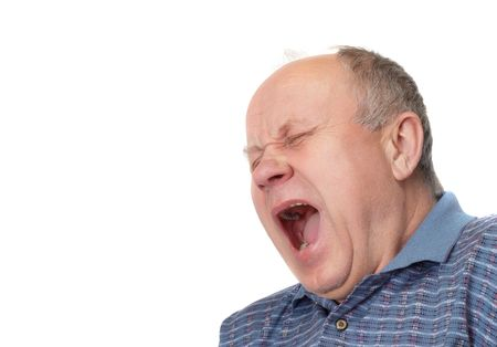 ennui: Bald senior man yawns. Emotional portraits series. Isolated on white. Stock Photo