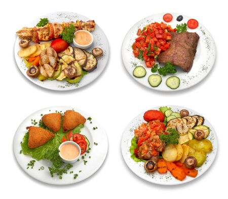 4 dishes of delicious food. Grilled meat and vegetables. Isolated on white. This image was composed using 4 different shots. Stok Fotoğraf
