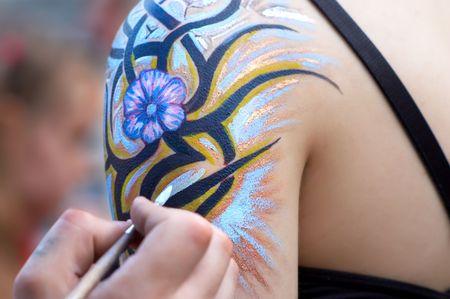 body painting in process. flourish design. selective focus. Reklamní fotografie