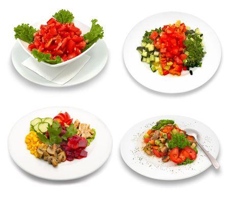 4 platos de ensalada. Aislado en blanco. Esta imagen fue compuesta con cuatro tomas diferentes.  Foto de archivo