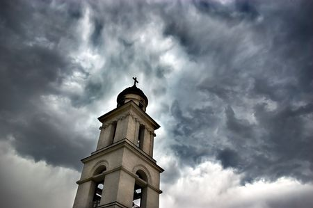 bell tower under dark dramatic skies before the storm photo