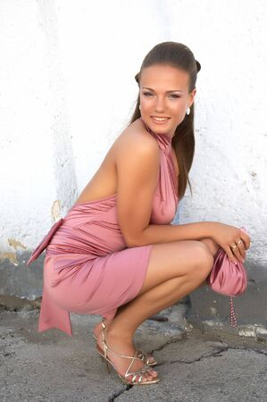young sexy girl in pink fancy dress squating down Stock Photo - 1171608