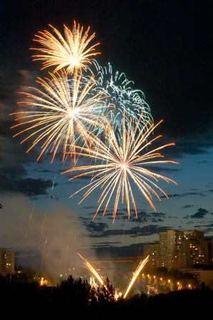 evening fireworks on the background of the city skyline photo