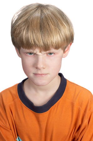 displeased: serious displeased blond boy, isolated on white