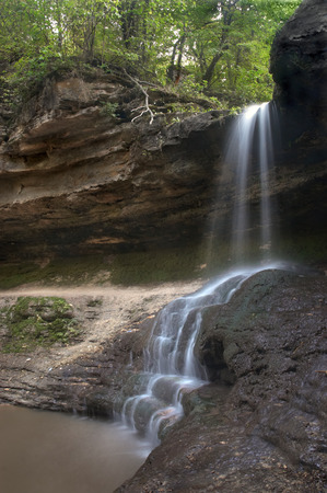 murmur: small waterfall in the forest. long exposure. Stock Photo