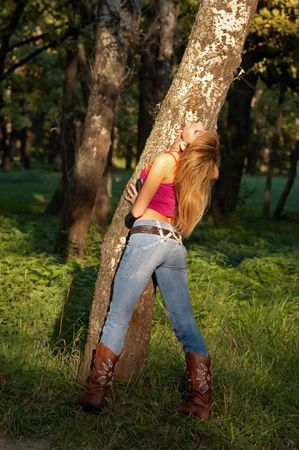 slim shaped beautiful blond girl enjoying forest in the warm rays of sunset Stock Photo - 1787729