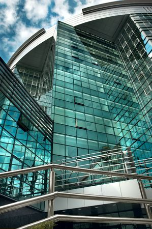 mirror-walled business center with reflection of cloudy sky Stock Photo - 1807395
