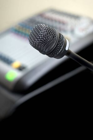 narration: microphone at background of sound mixer. selective focus, copyspace. Stock Photo