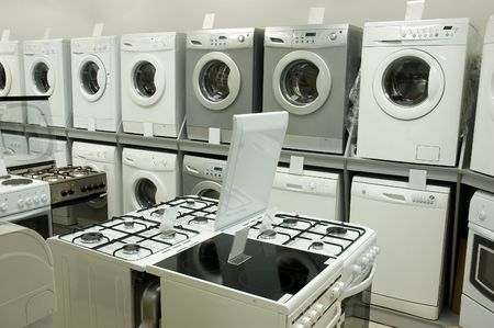spotřebič: Domestic equipment (washing machines and gas stoves) arranged in the store