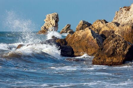 blue sea and rocks storming in light of sunset Stock Photo - 2248858