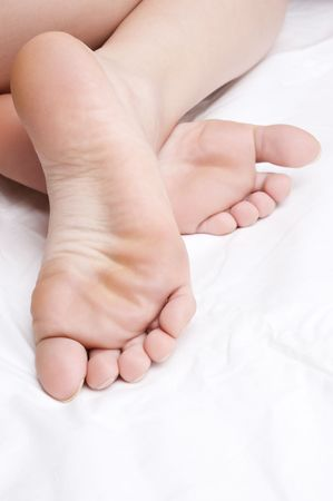 clean bare feet on white cloth.