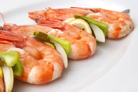 large juicy boiled shrimps served on plate photo
